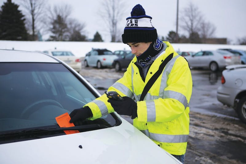 GVL / Emily Frye Junior Chad Jackson gives out a parking citation to one unlucky student in Lot H on Jan. 23rd.