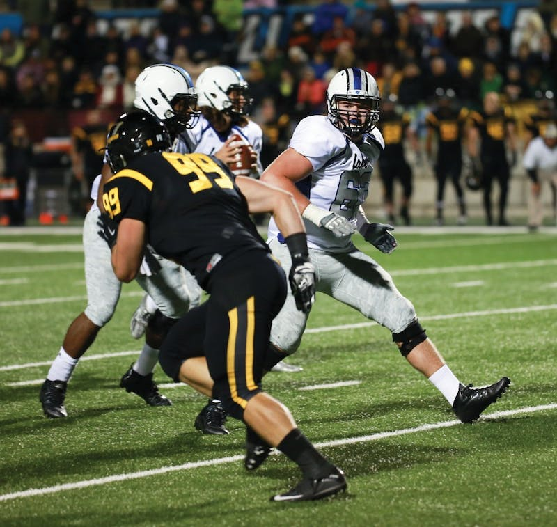 GVL / Kevin Sielaff -  Ben Walling (63) back pedals to block Bart Williams (6).  Grand Valley squares off against Michigan Tech Oct. 17 at Lubbers Stadium in Allendale. The Lakers defeated the Huskies with a score of 38-21.