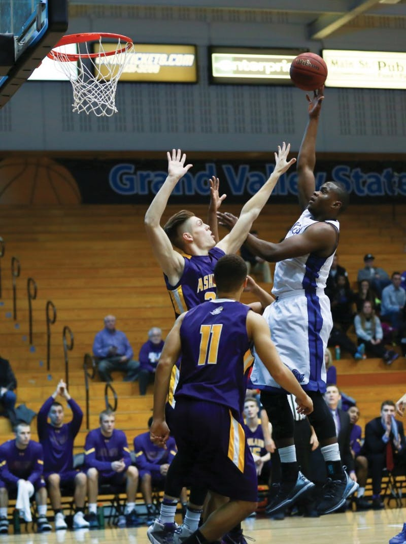 GVL / Kevin Sielaff - Trevin Alexander (5) tries a floater and elevates above the defense.  The Lakers fall to the Eagles of Ashland University in a tough overtime loss Dec. 3 in Allendale. The final score was 76-72.