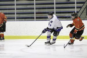 GVL / Sara CarteGrand Valley's DII Hockey player, Spencer Godin, keeps the puck away from Ferris State at Georgetown Ice Arena on Oct. 30.