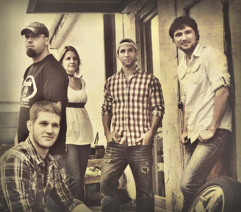Courtesy Photo / Christine GribbleSmall Town Son band members Dan Anspaugh, Bill Justice, Susan Belliel, Ian Szarafinski, and Kris Hitchcock will perform at GVSU's Country Night