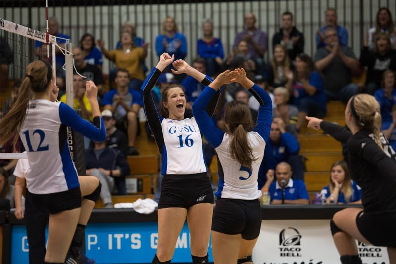 GVL / Luke Holmes - The team celebrates after scoring. GVSU volleyball lost to Michigan Tech on Saturday, Oct. 29. 2016.