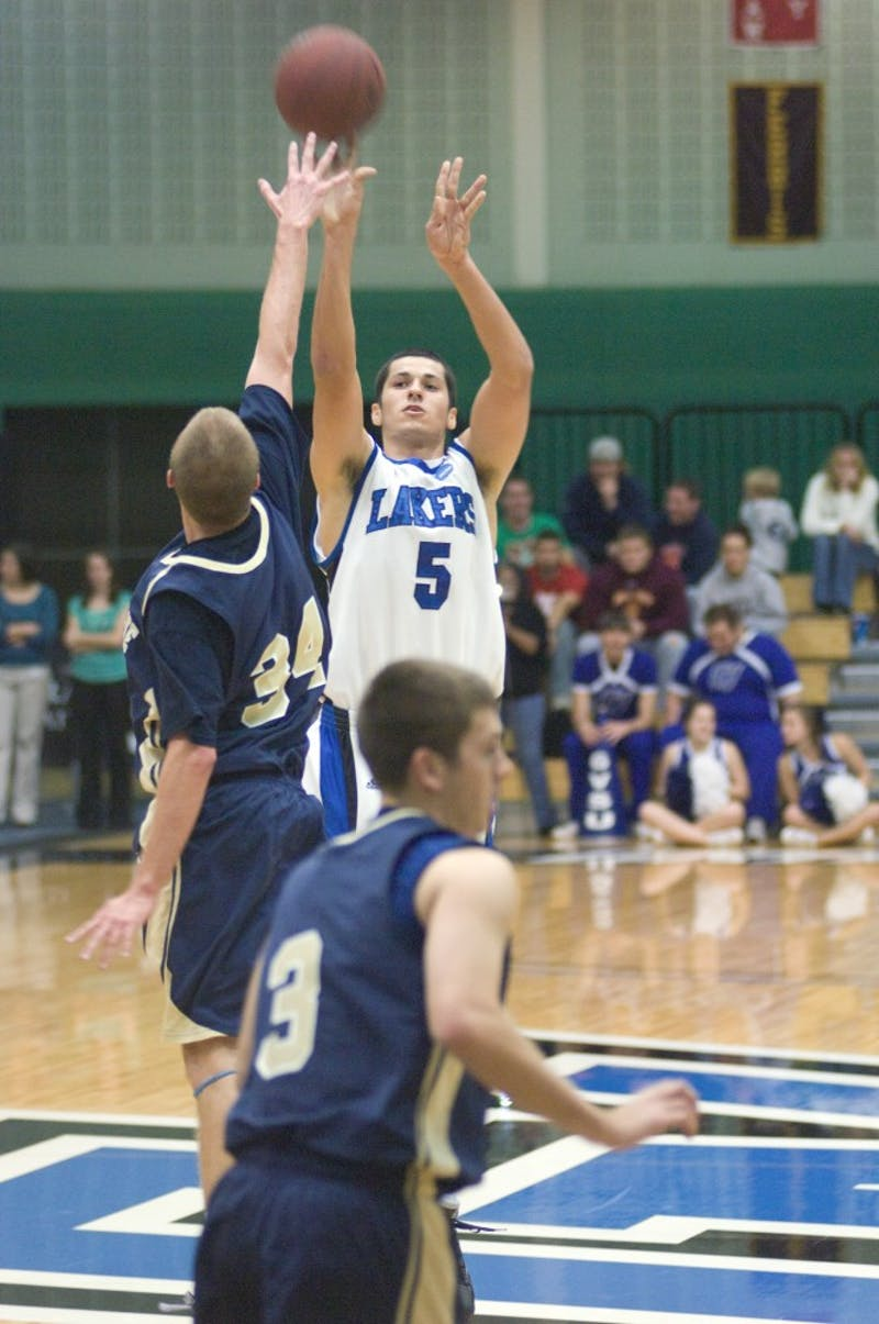 GVL Archive / Andrew MillsNick Carreri shoots the ball outside of the arc during a past game.