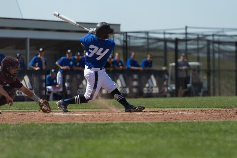 GVL / Luke Holmes - Brody Andrews grounds the ball at his feet. Grand Valley Men's Baseball lost to Walsh college 3-4 in the first game but won 15-8 in the second game.