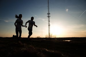 GVL / Luke Holmes - Jacob Salter and Casey Malburg go for a run around Grand Valley's campus.