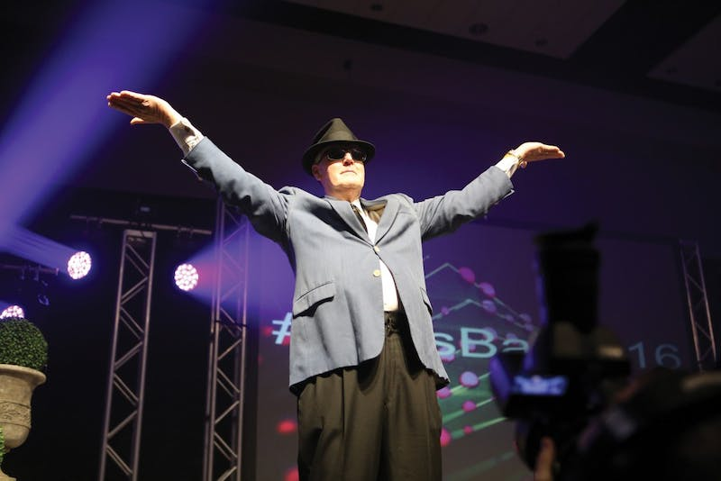 President Thomas Haas performs a blast from the past for the Laker crowd during the President's Ball on Friday Feb. 5, 2016. GVL / Archive