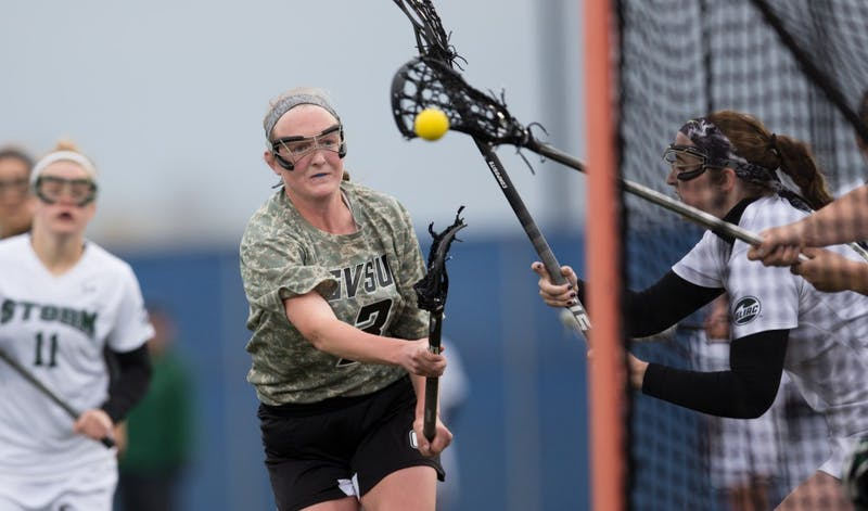 GVL / Kevin Sielaff - Erika Neumen (3) rips a shot on Lake Erie's net. Grand Valley defeats Lake Erie College with a final score of 19-2 on Friday, April 29, 2016 in Allendale.