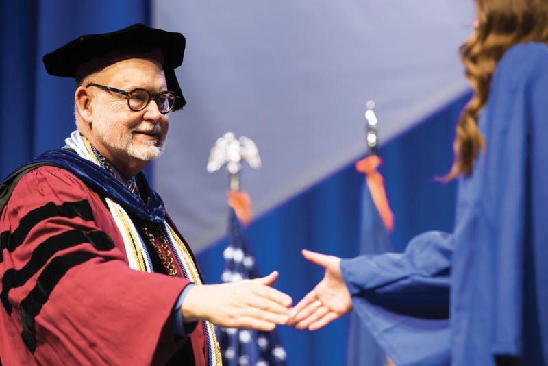 GVL/Archive Dean of the college of liberal arts and sciences, Frederick J. Antczak, shakes hands with students as they walk across the stage to recieve their diploma and graduate at the 2015 commencement ceremony, Saturday April 25.