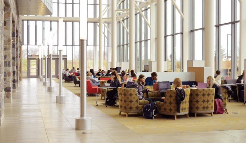 Students work inside the Mary Idema Pew Library on Wednesday, March 29, 2017. GVL / Hannah Zajac