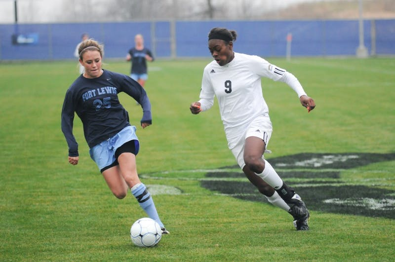 GVL / Andrew Mills Sophomore forward Kayla Addison dribbles past a Fort Lewis defender during Sunday's home game against Fort Lewis