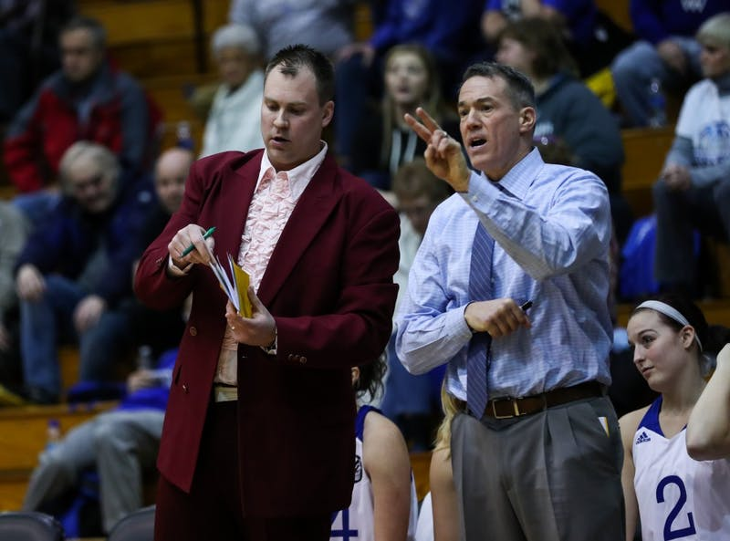 Head coach Mike Williams and Assistant Head Coach Phil Sayers talk on the bench during the game vs. Northwood inside the Fieldhouse Arena in Allendale on Thursday, Feb. 9, 2017.