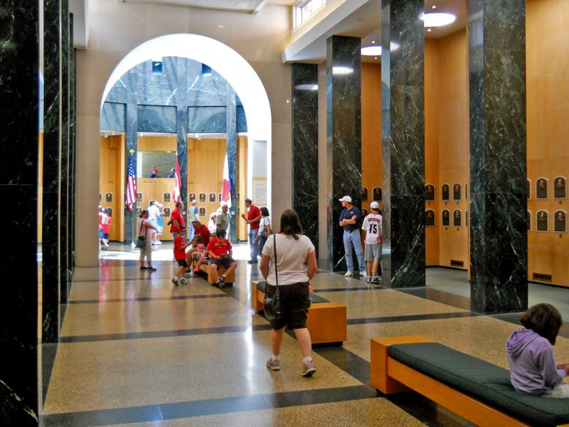 Tourists fill the plaque gallery at the Baseball Hall of Fame in Cooperstown, NY.