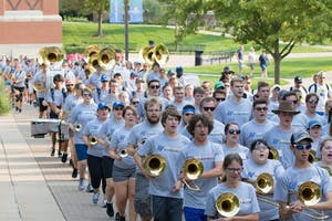 The GVSU Marching Band marches to a football open scrimmage during band camp to practice a performance.  Courtesy / Lindsey Willett