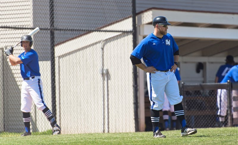 GVL/Luke Holmes - Assistant Coach, Cody Grice, watches his players between innings. Grand Valley Men's Baseball lost to Walsh college 3-4 in the first game but won 15-8 in the second game.