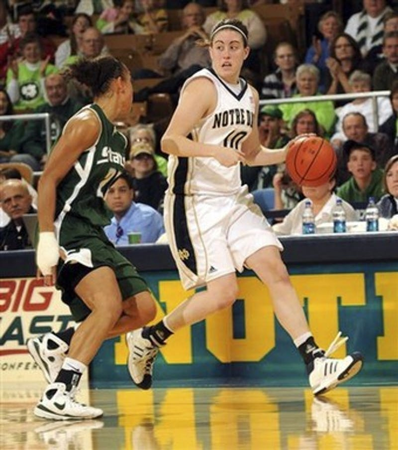 Notre Dame guard Kellie Watson, right, heads up court as Michigan State guard Brittney Thomas defends during second half in a NCAA college basketball game Saturday Nov. 29, 2008 in South Bend, Ind. Notre Dame won 78-72.  (AP Photo/Joe Raymond)