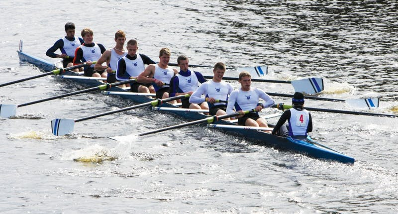 The varsity men row in an earlier regatta. They placed third in Lubbers Cup Regatta in Spring Lake.