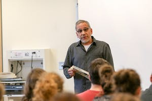 GVL / Sara Carte - Los Angeles Professor, Ruben Martinez, speaks about creative writing and reading in the Kirkhof Center on Wednesday, Feb. 24, 2016.