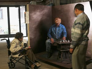 GVL / Marissa DillonHarris Building- People admire Robert Shangle as a living statue