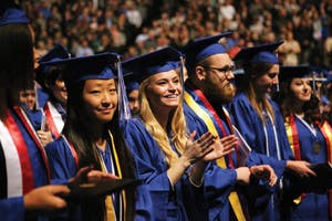 GVL/Emily Frye - Jesse Vogt awaits the start of winter commencement Saturday, December 12, 2015.