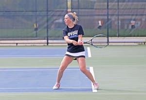 GVL / Emily Frye  Madison Ballard warms up before the match against Saginaw Valley State University on Sep. 12th, 2015.