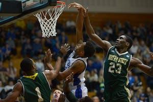 GVL / Luke Holmes - Chris Dorsey (14) attempts to score the basket. GVSU men's basketball defeated Wayne State University on Thursday, Jan.19, 2017.