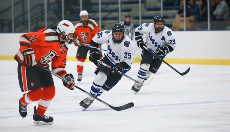 GVL / Kevin Sielaff -  Nick Schultz (25) races toward the puck. Grand Valley's Divison II men's hockey squad squares off against Bowling Green University Oct. 16 at Georgetown Ice Arena.