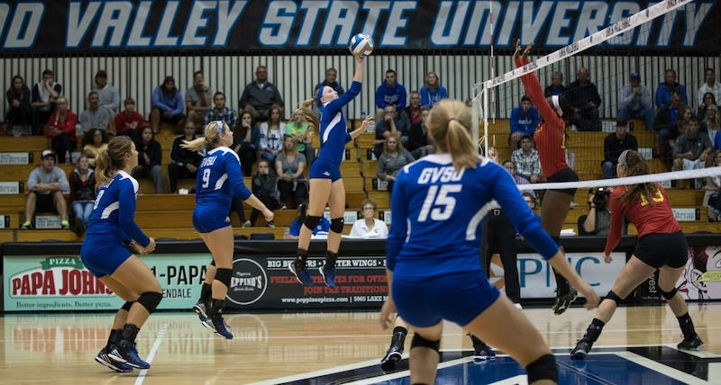 GVL/Kevin Sielaff - Kendall Yerkes (2) jumps and sends the ball over the net. The Lakers fall to the Bulldogs of Ferris State with a final score of 1-3 Tuesday, Sept. 27, 2016 in Allendale.