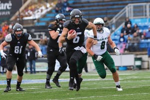 Bart Williams scrambles out of the pocket for a first down against Northwest Missouri State on Saturday, Nov. 17. GVL / Katherine Vasile