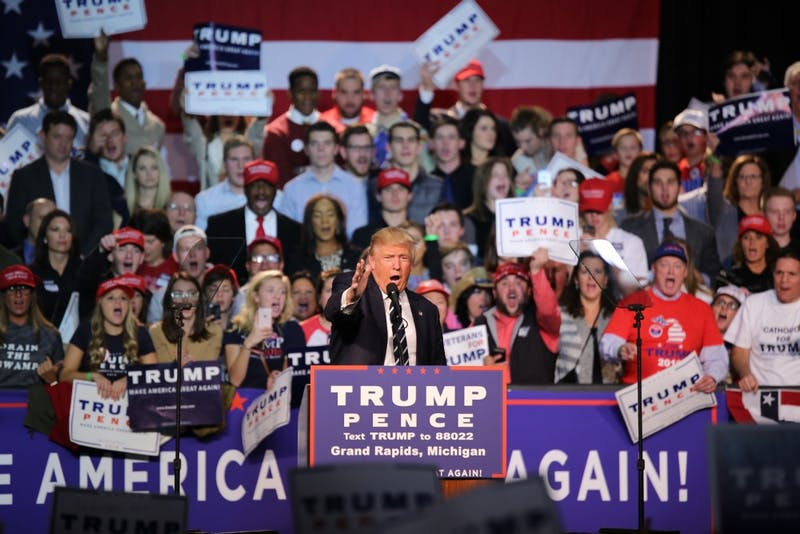 Republican presidential nominee Donald Trump excites the audience at DeVos Place in Grand Rapids, Michigan during his late-night rally less than 12 hours before polls open to voters.