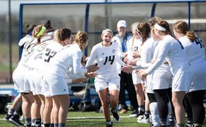 GVL / Kevin Sielaff – Chloe Zdybel (14) runs onto the field as the starting line-up is called. The Lakers defeat the Bearcats of McKendree University with a final score of 23-11 Friday, March 25, 2016 in Allendale.