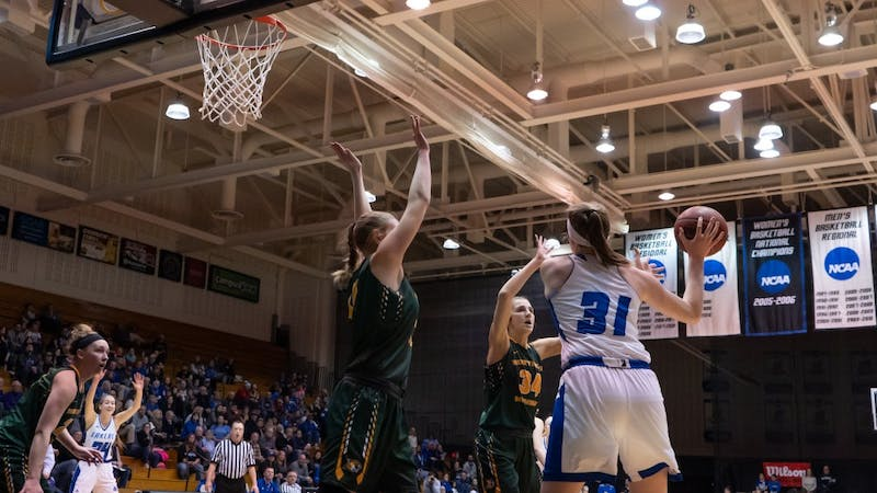 GVSU womens basketball semi-finals. Cassidy Boensch goes up against Northern Michigan defenders.   GVL / Ben Hunt