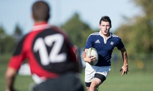 GVL/Kevin Sielaff - Andrew Novak (10) moves the ball up field and scores. GVSU men's club rugby defeats rival SVSU by a large margin Saturday, Sept. 24, 2016.