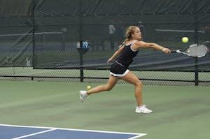 GVL/Lauren LoriaGVSU Tennis Player Abby Perkins plays against Wayne State University Saturday.