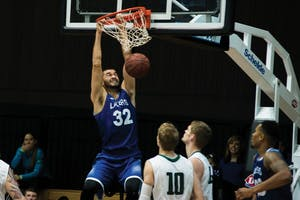 GVL/Luke HolmesRicardo Carbajal (no.32) slams the ball down for the dunk. The Lakers lost to Lake Erie College 78-84 on Dec. 5.