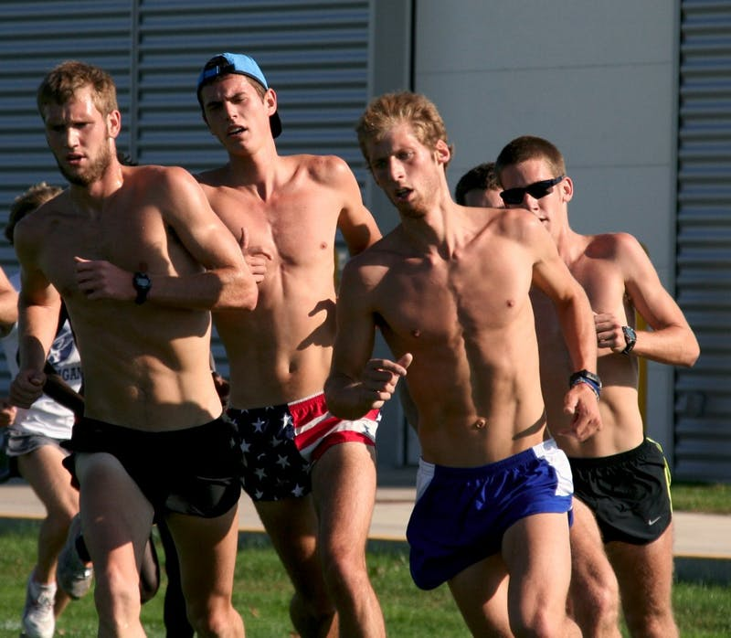 Tyler Emmorey (pictured in the blue shorts) runs with team mates during practice