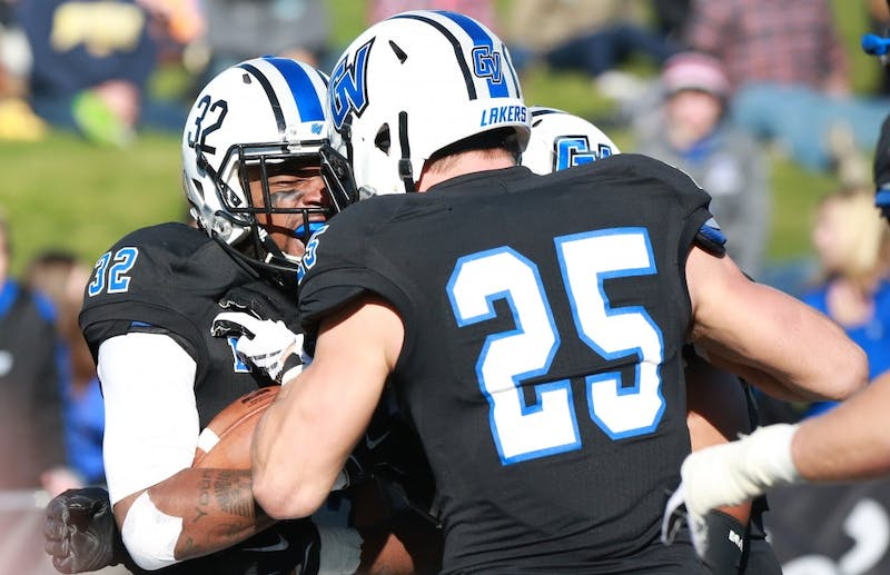 GVL / Kevin Sielaff - Donte Carey (32) intercepts an SVSU pass and returns posession to Grand Valley.  Grand Valley squares off against SVSU Nov. 14 in Allendale. The Lakers hold on and win with a final score of 24-17.