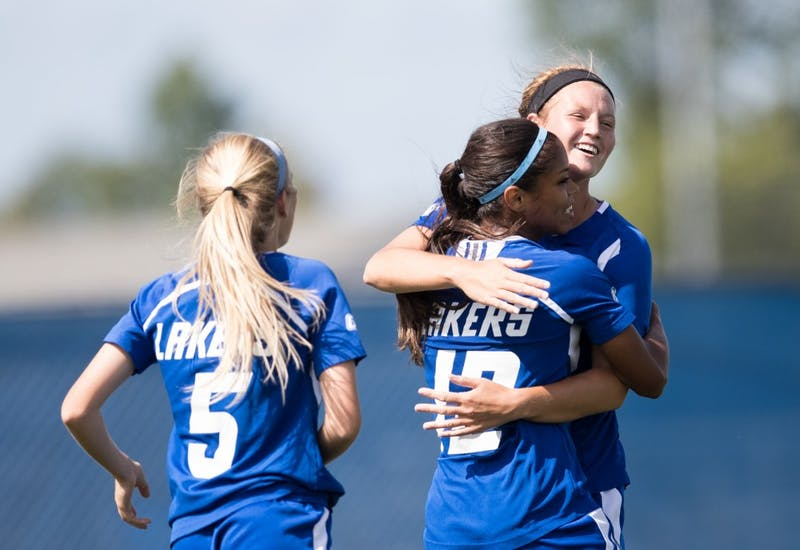GVL/Kevin Sielaff - Madz Ham (9) and Jayma Martin (12) celebrate a Grand Valley goal. The Lakers defeat the Panthers of Ohio Dominican with a final score of 4-0 on Sunday, Sept. 18, 2016 in Allendale.