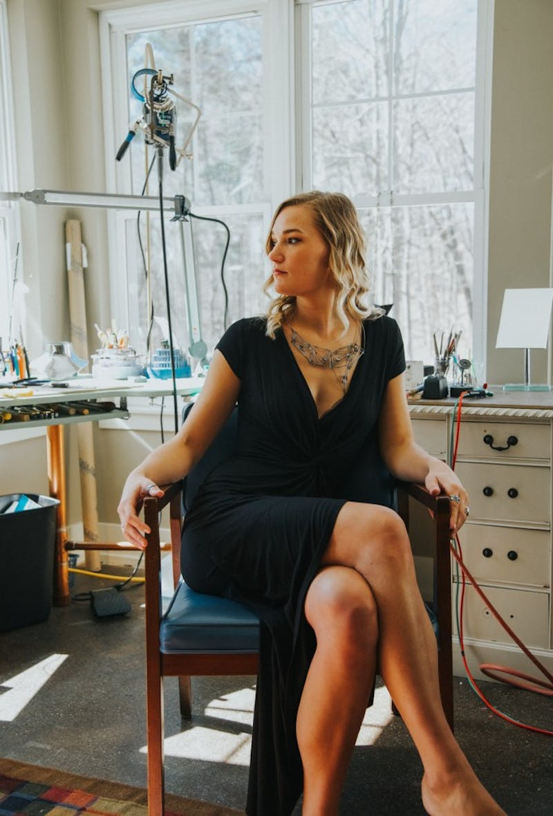 Alumna Emma Hoekstra sits in her studio. Hoekstra placed top five in the Halstead Grant competition because of the successes of her jewelry business. Courtesy / Emma Hoekstra