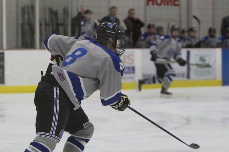 GVL/Mackenzie Bush - Chuck Reed (8) races to the puck. GVSU Men's D3 Hockey plays Michigan State University Saturday, Dec. 10, 2016.