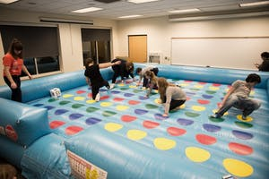 GVL/Luke HolmesKids play a giant version of twister in the Kirkhof Center for Sibs and Kids Weekend Friday, Jan. 29, 2016.
