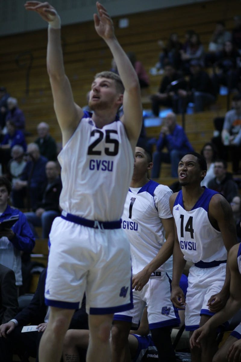GVL / Sheila BabbittTeammates Chris Pearl and Chris Dorsey cheer on Ben Lubitz as he shoots a three at the game vs Ashland on February 15th, 2018.