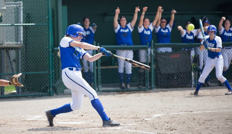 GVL/Kevin Sielaff - Ellie Balbach (11) squares up and hits a home run. Grand Valley State squares off against Wayne State in the second game of the Midwest Super Regional tournament. The Lakers came out with the victory with a final score of 1-0 on Thursday, May 12, 2016 in Detroit, MI.