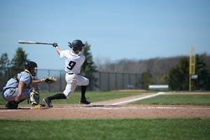 GVL / Luke Holmes -  Josh Smith (9) nails a double. GVSU Men's Baseball faced off against Ohio Dominican in a double header on Saturday, April 8, 2017.