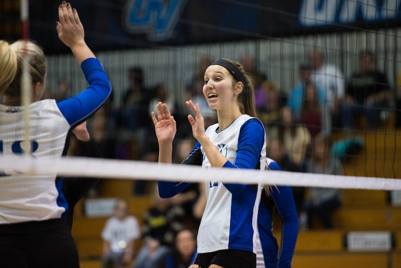 GVL / Luke Holmes - Jillian Butsavich (12) high fives her teammate. GVSU volleyball lost to Michigan Tech on Saturday, Oct. 29. 2016.
