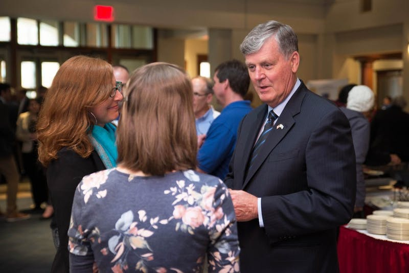 GVL / Luke Holmes - President Haas speaks with a student about the project she runs.The Civic Engagement Showcase was held in the DeVos Center in downtown Grand Rapids on Thursday, April 13, 2017.