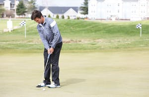 GVL/Kevin SielaffDomenic Mancinelli warms-up before a practice match at the Meadows Golf Course in Allendale Wednesday, April 29, 2015.