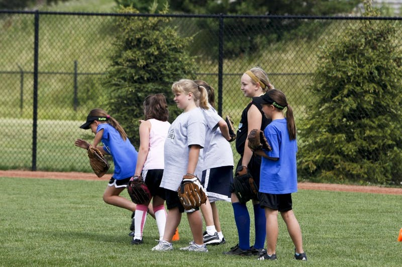 Young softball players develop their skills during a camp on GVSU's campus on June 29-30
