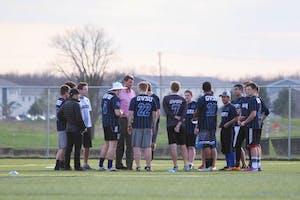 GVL/Mackenzie Bush - The GVSU Ultimate Frisbee team gathers before their game Monday, April 17, 2017.