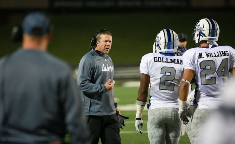 GVL / Kevin Sielaff -  Head coach Matt Mitchell consults his men on the sideline.  Grand Valley squares off against Michigan Tech Oct. 17 at Lubbers Stadium in Allendale. The Lakers defeated the Huskies with a score of 38-21.