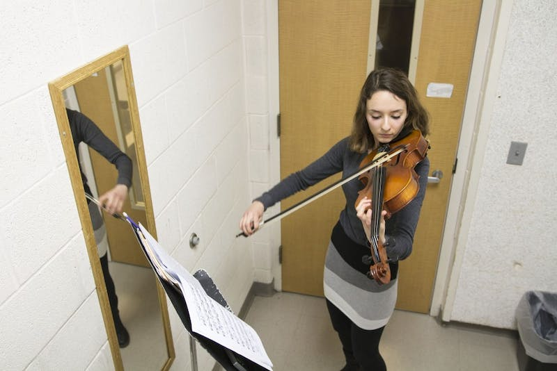 GVL / Sara CarteMusic Eduaction major, Ashley Qooistra, practices playing her violin in a practice room in the Performing Arts Center on Friday, Jan. 29, 2016.